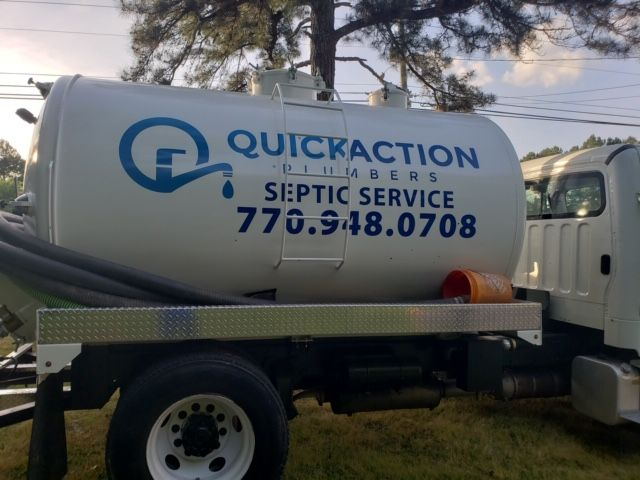 Quick Action Plumbers septic truck